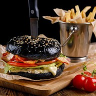 Бургер с мясной котлетой Фото