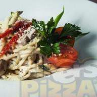 С овощами в соусе из белых грибов Фото