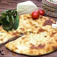 Осетинский пирог с сыром,листьями свеклы Фото