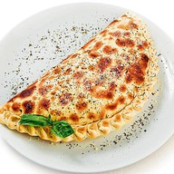Пицца закрытая куриная Фото