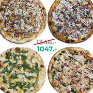 4 круглые пиццы по цене трёх Фото