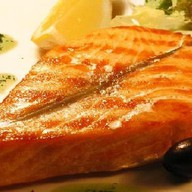 Стейк из лосося на гриле Фото