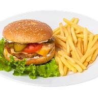 Бургер Чикен де люкс с картофелем фри Фото
