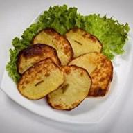Печеный картофель на углях Фото