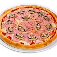 Ветчина и грибы пицца Фото