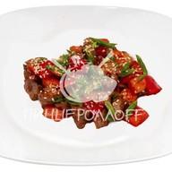 Говядина с овощами в томатном соу Фото