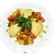 Тилапия с овощным соте Фото