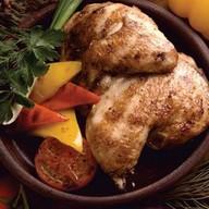 Цыпленок в чесноке и специях Фото