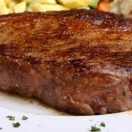 Стейк из говядины с овощами Фото
