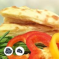Осетинский пирог с капустой и сыр Фото