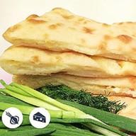 Осетинский пирог с сыром и зелены Фото