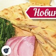 Осетинский пирог с ветчиной и сыр Фото