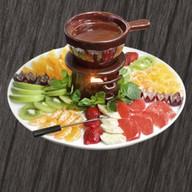 Шоколадное фондю с фруктовым ассорти Фото