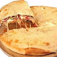 Пицца кальцоне Фото