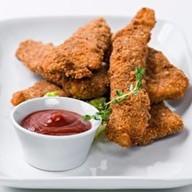 Куриные наггетсы с соусом на выбор Фото