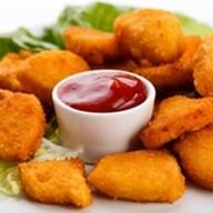 Куриные наггетсы с кетчупом Фото