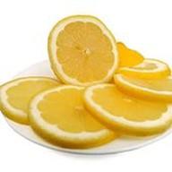 Лимон нарезкой Фото