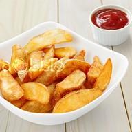 Картофельные дольки по-деревенски Фото