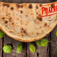 Пицца с ветчиной и сыром Кальцоне Фото