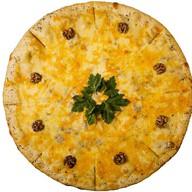 Пицца «Четыре сыра» Фото