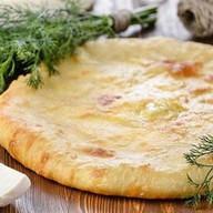 Осетинский с лососем и рисом Фото
