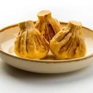 Сет жареный из хинкали с курицей, цукини Фото