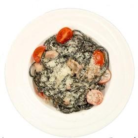 Спагетти allnero с морепродуктами - Фото