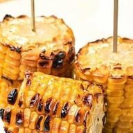 Кукуруза запеченная на углях Фото