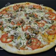 Пицца с морепродуктами Фото