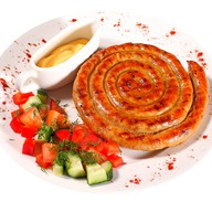 Колбаски немецкие с соусом Фото