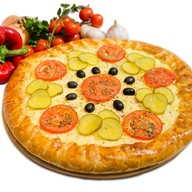 Пицца-пирог Coffee-hаll с лососем Фото