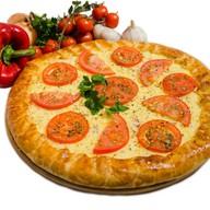 Пицца-пирог Coffee-hаll с колбасками Фото
