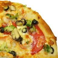 Пицца из морепродуктов Фото