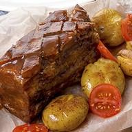 Запеченная свиная грудинка Фото