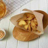 Картофельные дольки + соус в подарок Фото