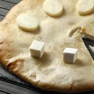 Осетинский пирог с картофелем, брынзой Фото